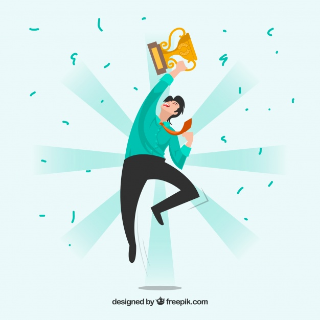 a successful man who jumps up holding the cup